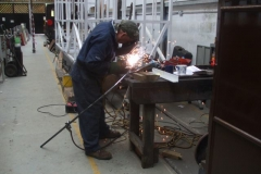 … while elsewhere, Adrian is welding supports to the first of the vestibule handrails.