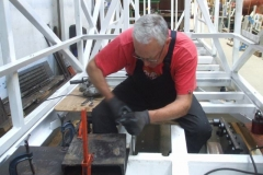 Andy has reached the other end of carriage No. 24, and is securing the bogie retaining bolts to the frames …
