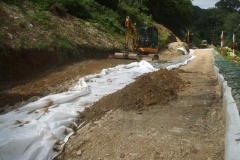 … to spread and roll on the stone prior to teasing the geotextile out and filling the gap between …