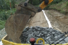 Southern Extension. Pont y Goedwig Deviation Project. Tuesday, 1.9.2020. Making the most of a short spell of dry weather, quarry rejects are scooped out of the dumper …