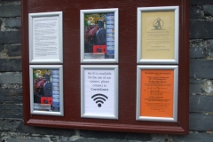 … Dick has re-assembled the display frames on the newly painted notice board outside the S&T Shed …