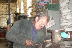 … and Trefor is in his element, cleaning faces of exhaust pipes to take new gaskets.