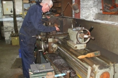 … while Bob continues turning parts for additional screw couplings …