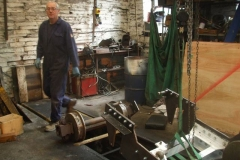 Andy makes a start on removing the wheelsets from the new carriage bogie so that the axleboxes can be removed and appropriate spacers inserted before they are re-secured again.