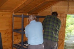 In the meantime, a start has been made on assembling shelving in the new S&T Shed.
