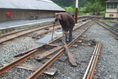 """New walkways having been cut for the """"2 foot"""", Dick removes rotten boards before securing the new gratings in place …"""
