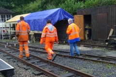 Wednesday, 2.9.2020. Ben, Sam & Richard take a walk past the Waggon Shelter to view stored waggons further down the line, with a tarpaulin over the Waggon Shelter roof to give protection from showers.