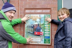 Wednesday 04.04.2018 Jack helps put up the new poster on Wharf Station...
