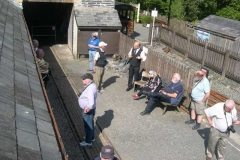 Some of the group hide from the sun outside the Engine Shed …
