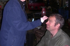 … so Sue soothes insect repellent on to Trefor's face (amongst others!) …