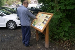 """A new """"Corris"""" Information board (to match those around Corris and Aberllefenni) has been erected by the railway at CAT and attracts interest straight away!"""