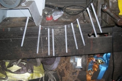 A number of dowels have been fabricated and primed for the point rodding outside.