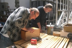 Charles and Derek work on various parts of carriage No. 22 …