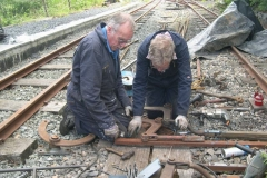 Outside the Signal Box, John and Andrew are puzzling over setting up the point rodding …