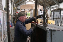 It must be a sign we are all getting older! Ade uses the hoist to lift the Magdrill to finalise some holes in the waggon body …
