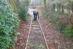 However, the rail is wet and the load heavy, so Trefor places some (very!) lumpy sand on the rail to control our descent …