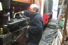 In the Engine Shed, Trefor is filling No. 7's boiler with water while checking for leaks …