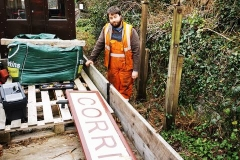 On inspection, it was decided that the current running in board for Corris Station is a little worse for wear, Sam 'the vandal' poses with the sign after its removal for patching up and repainting.