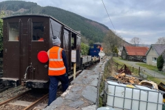 The gang close the gates at Braich Goch Farm accommodation crossing to remind regular users of the railways' presence.