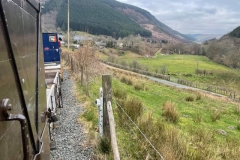 The train negotiates the bend at the bottom of Maes Y Llan bank on the approach to Corris – the train was welcomed by much excitement from residents of the village.