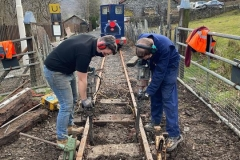 With the track jacked to the correct level/alignment, Jack and Josh tamp the track firmly in place.