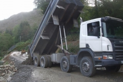 ... but one more load is delivered and spread before stopping until weather conditions improve.
