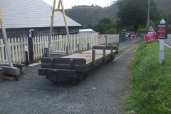 ... and after a sizeable shunt to put waggons back in order after the recent photo charters, waggon No. 218 has been left on the car park at Maespoeth in anticipation of the delivery of sleepers for Corris Station.
