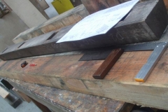 ... which are trimmed to length and set out in accordance with drawings and the original replica components.