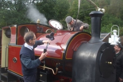 ... while once outside (and watering), Tony uses his bicycle pump to blow soot off the saddle tank as directed by Stevie (and to Trefor's amusement)!