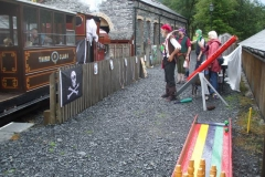 "… and staff ""manning"" the games wave off the first happy passengers as their train heads back towards Corris."