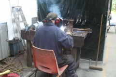 Meanwhile, Adrian continues with his welding of waggon axlebox horns.
