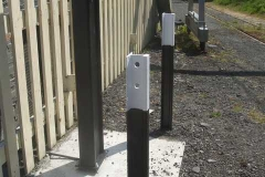 Monday, 26.7.2021. The rails protecting the ev charging point in the car park at Maespoeth, have received their final colours.