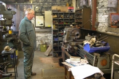 In the Engine Shed, Bob takes the last cut on the second axlebox for carriage Nos. 23 & 24 …