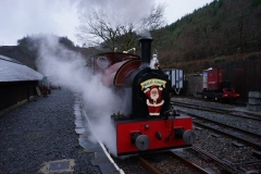 … and the loco's lamp is lit as an elf waves off the passengers of the last train of the day.
