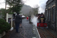 Last minute preparations to greet visitors are being made as No. 7 draws forward before dropping back on to its train …