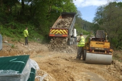 More stone arrives for filling gabions …