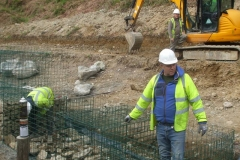 Tuesday, 5.5.2020. It's a cold start, filling gabions at the north end of the existing wall …