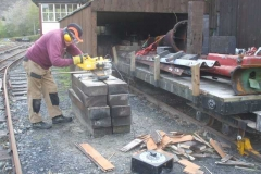 … while outside, John cuts up firewood for No. 7.