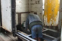 Tony paints the frames of the P Way van in black bitumen …
