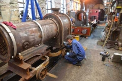 Boiler Inspector Graham Morris writes details of the plate thickness onto the firebox of Number 7.