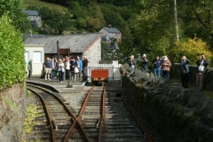 There is a good crowd to greet the train in Corris!