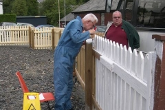Tuesday, 9.8.2016. Phil continues painting the fence in Corris …