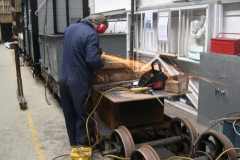 … Adrian continues his work by grinding surplus weld away …