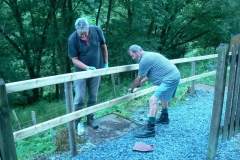 Peter and Richard the Second have decided to give the new fence on the pedestrian access to the carriage shed an initial coat of preservative.