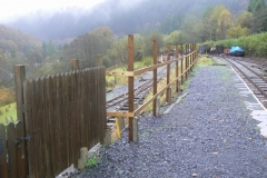 The framework for the South Platform fence awaits the pales being made over the winter