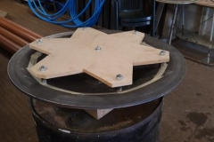 A jig to hold the baffle plate fixings in place for tack welding.