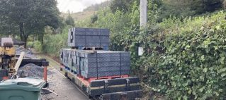 6th October 2021. Sleepers are loaded and awaiting a locomotive to bring them down to outside the engine shed.