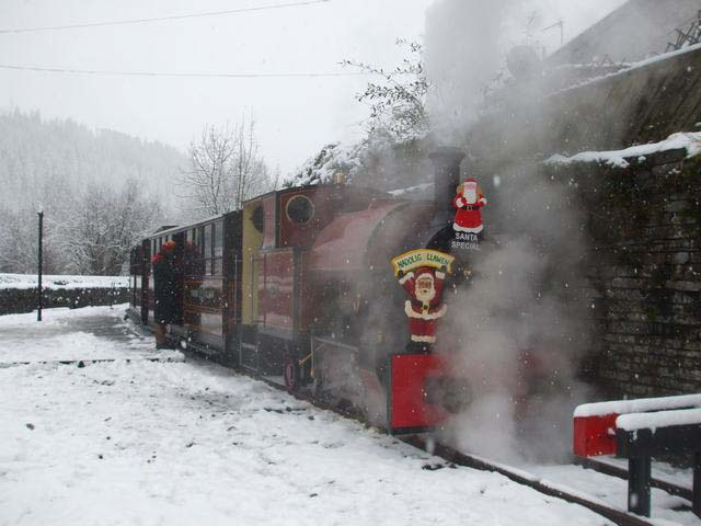 Tickets are checked before a train departs from Corris to Maespoeth for the passengers to visit Santa